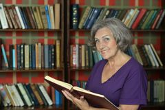 Beautiful elderly woman with book Stock Photography