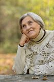 Beautiful elderly woman outdoors Stock Photo