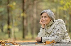 Beautiful elderly woman outdoors Stock Image