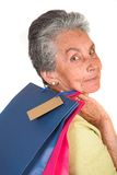 Beautiful elderly woman with shopping bags Stock Images