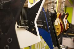 Color electric guitar exposition in a store royalty free stock image