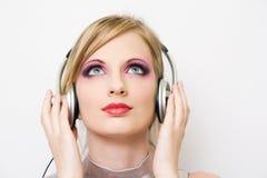 Beautiful electro pop girl in headphones. Beautiful blond electro pop gir enjoying music in headphones Stock Photos