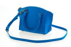 Beautiful elegance and luxury fashion women and blue handbag. Beautiful elegance and luxury fashion women and blue leather handbag isolated on white background Stock Images