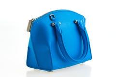 Beautiful elegance and luxury fashion women and blue handbag. Beautiful elegance and luxury fashion women and blue leather handbag  on white background Royalty Free Stock Photos
