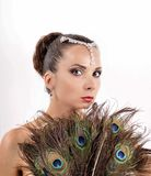 Beautiful elegance young girl with peacock feathers Royalty Free Stock Photography