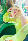 Beautiful elegant blonde fashion woman portrait in amusement park summer royalty free stock photography