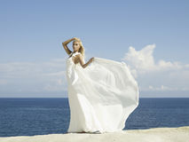 Beautiful elegant bride at the seashore Royalty Free Stock Image