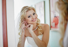 Beautiful and elegant bride smiles is preparing for the wedding ceremony Royalty Free Stock Image