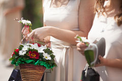 Beautiful elegant bridesmaid holding basket of colorful bouquet Stock Photography