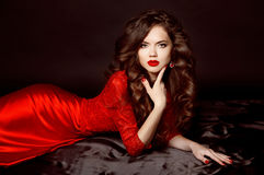 Beautiful elegant brunette woman model wearing in fashion red dr Royalty Free Stock Image