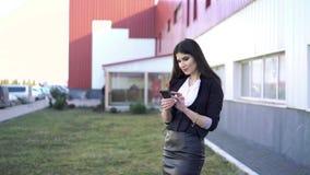 Beautiful elegant business woman using smartphone stock video