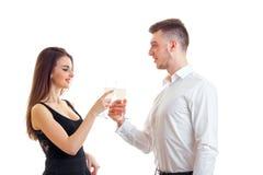 Beautiful elegant couple drinking champagne Royalty Free Stock Photography