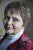 Beautiful elegant elderly lady at home. Beautiful elegant elderly lady gray hair at home Stock Image