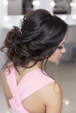 Beautiful elegant evening hairstyle on dark hair beautiful girl with an ornament from stones in her hair, hairstyle for the weddin Stock Photography