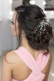 Beautiful elegant evening hairstyle on dark hair beautiful girl with an ornament from stones in her hair, hairstyle for the weddin Royalty Free Stock Photography