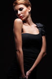 Beautiful elegant female in black dress Royalty Free Stock Photos