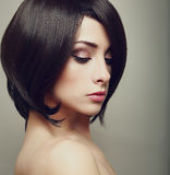 Beautiful elegant female with black short hair. Stock Photography
