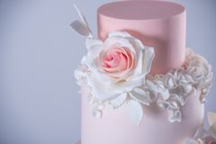 Beautiful elegant four tiered pink wedding cake decorated with roses flowers. Concept floral from sugar mastic. Beautiful elegant four tiered pink wedding cake stock photography