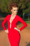 Beautiful elegant girl with beautiful makeup and hair in a red evening dress in the Park Royalty Free Stock Photography