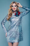 Beautiful elegant girl in brilliant paillettes dress. Portrait of beautiful elegant woman in brilliant fashionable paillettes dress on blue background in studio Royalty Free Stock Photography