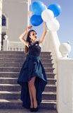 Beautiful elegant girl with dark hair with baloons Stock Image