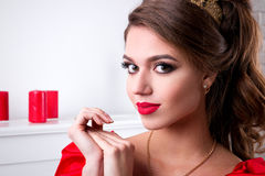 Beautiful elegant girl in a long red dress and shoes is standing Royalty Free Stock Photo