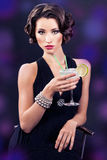 Beautiful elegant girl with a martini glass Stock Photo