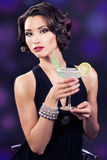 Beautiful elegant girl with a martini glass Stock Photos