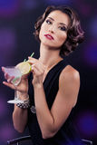 Beautiful elegant girl with a martini glass Royalty Free Stock Photography