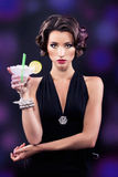 Beautiful elegant girl with a martini glass Stock Image