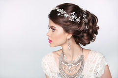 Beautiful elegant girl model with jewelry, makeup and retro hair Royalty Free Stock Images
