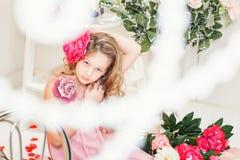 Beautiful elegant girl posing with flower Stock Photography