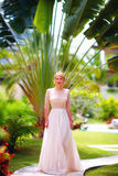 Beautiful elegant girl walking through the summer garden Royalty Free Stock Images