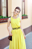 Beautiful elegant girl in yellow dress Stock Photos