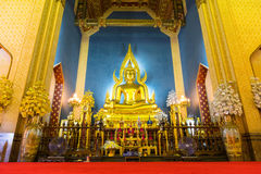 Beautiful elegant golden buddha statue in main church of Marble Royalty Free Stock Photo