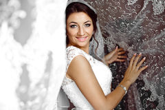 Beautiful elegant happy brunette bride on the background of a tu Royalty Free Stock Images