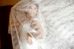 Beautiful elegant happy brunette bride on the background of a tu. Lle in a room in the morning Stock Images