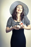 Beautiful elegant happy woman opening red bow gift box and dream Royalty Free Stock Photography