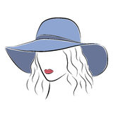 Beautiful elegant lady in the blue wide-brimmed hat. Royalty Free Stock Images