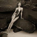 Beautiful elegant lady at huge boulder Stock Photo