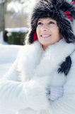 Beautiful elegant lady in snowy winter forest Royalty Free Stock Photos