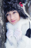 Beautiful elegant lady in winter forest Royalty Free Stock Photography