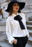 Beautiful elegant ladylike woman in blouse and felt hat Stock Photography