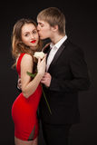 Beautiful elegant love couple wearing suit and red dress with wh Stock Images