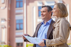 Beautiful elegant mid age couple standing outdoors. Royalty Free Stock Photography