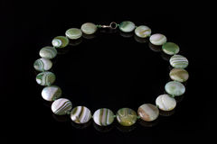Beautiful, elegant necklace of white and green agate beads stock image