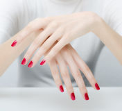 Beautiful elegant pale hands and long gracious fingers Stock Images