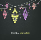 Beautiful Elegant Ramadan Mubarak Lanterns. Or Fanous Hanging With Colorful Lights in Islamic Pattern Background for the Holy Month Occasion of fasting Stock Photo