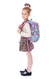 Beautiful elegant schoolgirl with satchel on his Stock Photos