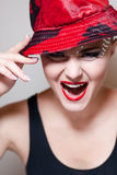 Elegant young woman with red hat & crystals shouting Stock Photos